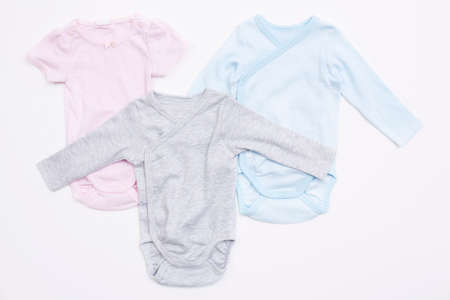 Three babygro's against white background