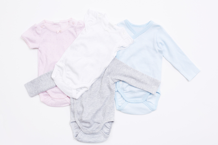 Four babygro's against white background