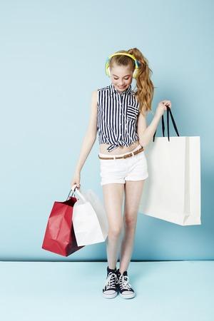 Teenage girl living to shop in studio
