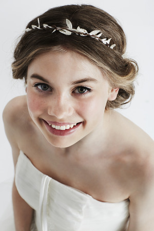 Beautiful teenage flower girl in white,  smiling