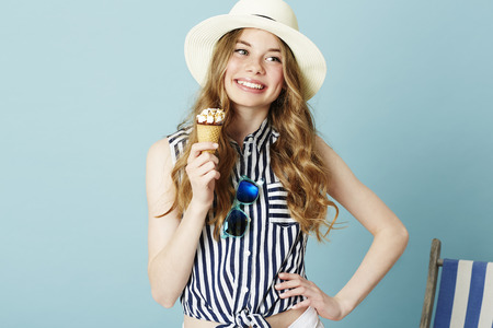 Pretty teen girl holding ice cream ready for summer