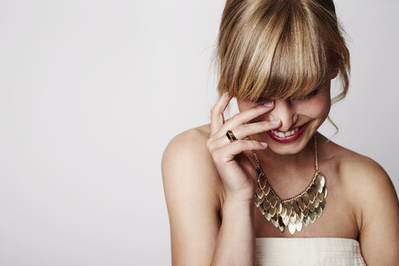 Photo for Beautiful blond laughing with gold necklace, close up - Royalty Free Image