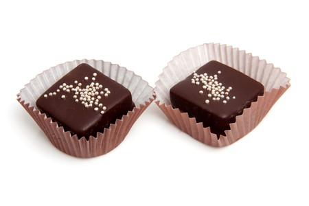 delicious chocolate petit four over white background