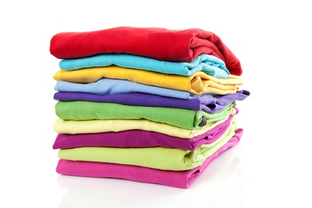 Photo pour Pile of colorful clothes over white background - image libre de droit