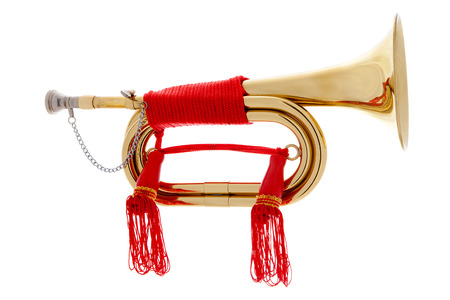 Golden horn with red rope over white background