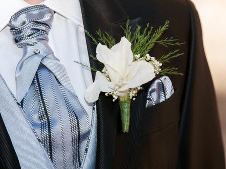 boyfriend jacket in dark color with flower on her
