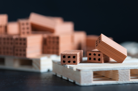 Foto de Clay bricks used for close-up miniature on black background  - Imagen libre de derechos