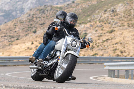 Photo pour biker circulating on asphalt; photograph captured during the month of September 2020 in the province of Avila, Spain. - image libre de droit
