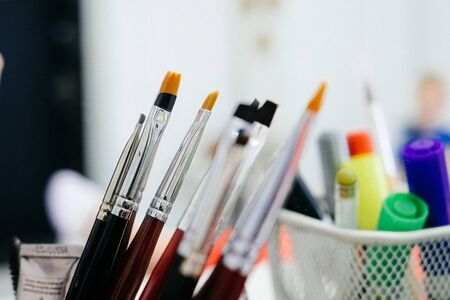 Photo for Set of cosmetic brushes in glass on light background - Royalty Free Image