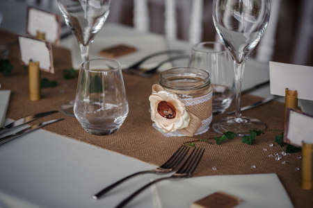 Photo pour Outdoor catering dinner at the wedding with homemade garnishes decoration. Rustic and boho style decor, natural materials, figures of deer, green and brown - image libre de droit