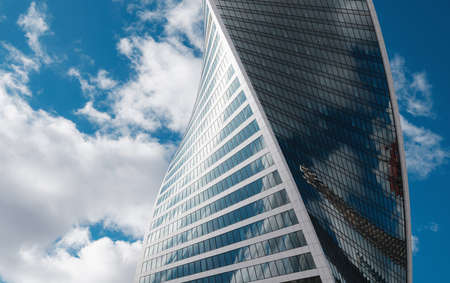 Photo pour Modern corporate buildings against blue cloud sky in winter cold day. High-rise buildings in Moscow city. low angle view - image libre de droit