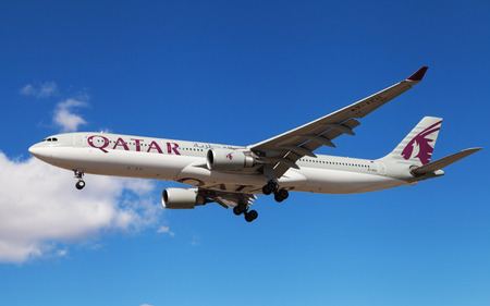 Barcelona, Spain - March 5, 2016: A Qatar Airways Airbus A330-302 approaching to El Prat Airport in Barcelona, Spain.
