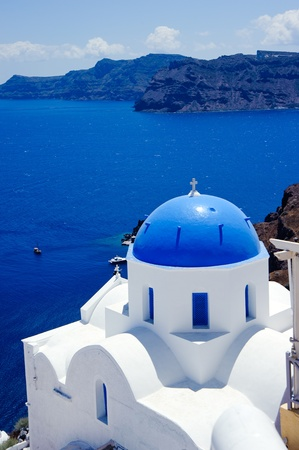 blue dome churches and classic cyclades architecture over the mediterranean sea in oia santorini island,greek