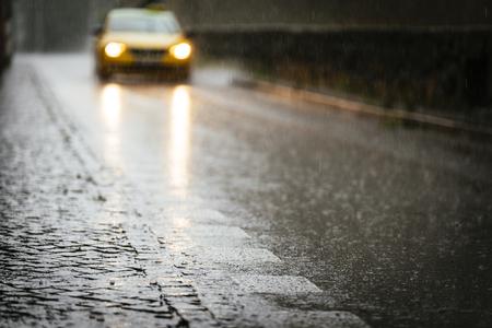 Photo pour Taxi circulating on wet asphalt while its raining. Rain Concept. - image libre de droit