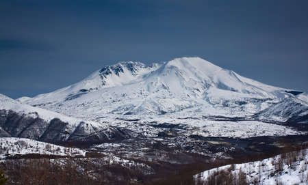 landscape view of a snow capped mountain peak