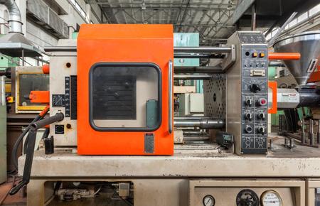 Photo pour Injection molding thermoplastic machine close up - image libre de droit