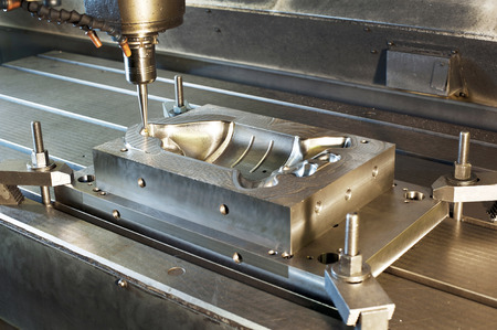 Industrial metal mold/ blank milling. Metalworking and mechanical engineering. CNC technology.