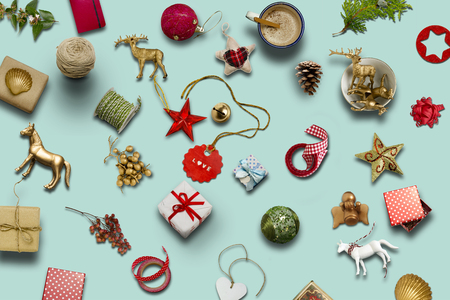 Foto de Christmas collection, gifts and decorative ornaments, on blue background. photographic montage - Imagen libre de derechos