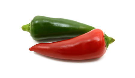 Hot green and red chillis, isolated on a white background