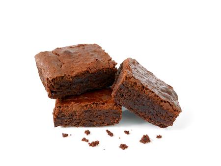 Foto de Pile of brownies with crumbs isolated on white - Imagen libre de derechos