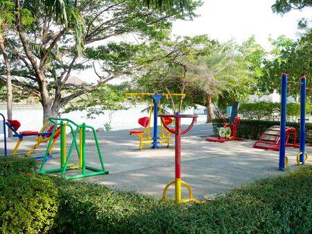 Foto de Colorful exercise equipment in the park in evening - Imagen libre de derechos