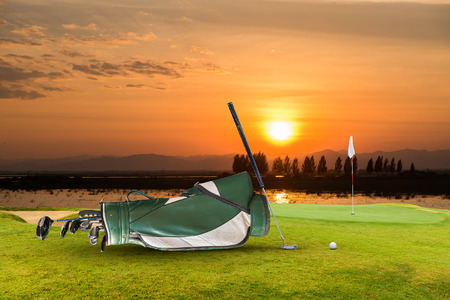 golf equipment ,golf ball on green and hole as background.
