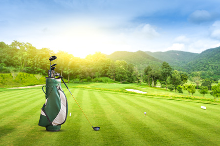 Foto per Golf equipment and golf bag golf ball on green at golf course  sunset blue sky as background. - Immagine Royalty Free