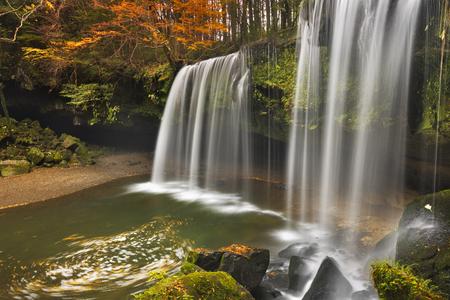 The Nabegataki Falls on the island of Kyushu, Japan surrounded by autumn colours.