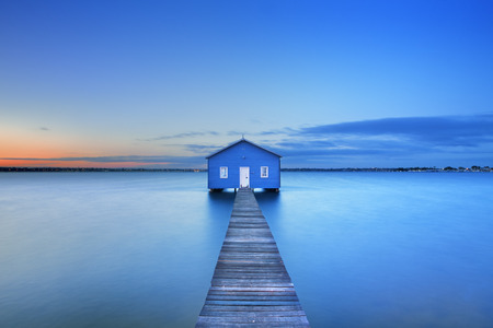 Sunrise over the Matilda Bay boathouse in the Swan River in Perth, Western Australia.