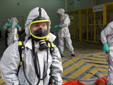 Rayong Thailand , February 09 - 2018 : Emergency team wearing chemical protection suit for work in dangerous chemical in factory.