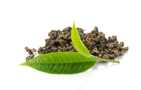 Green tea leaves and dry tea on white background.
