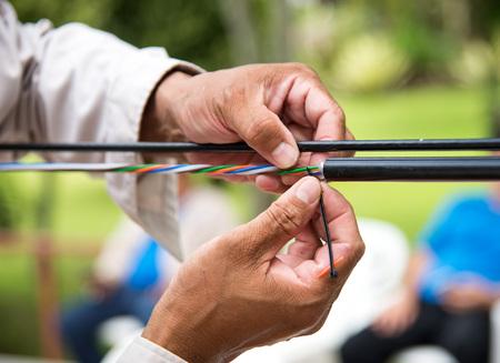 Photo pour Technicians are installing optic fiber. - image libre de droit