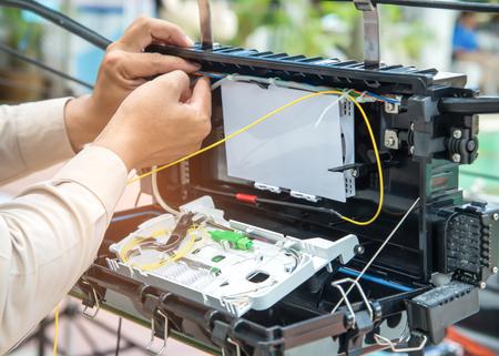 Photo pour Technicians are installing fiber optic cabinets for high speed internet. - image libre de droit