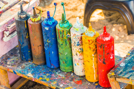 Paint bottles to be squeezed for art and craft education background