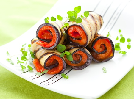 Grilled aubergine rolls stuffed with red peppers