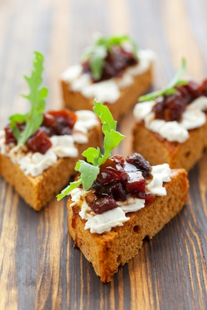 Pumpkin and tomato chutney on pumpkin bread with soft cheese