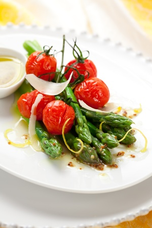 green asparagus with roasted tomatoes,cheese and lemon mustard dressing