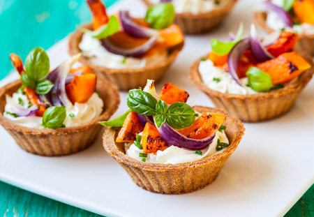 mini tarts with pumpkin and  soft cheese for holiday