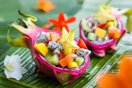 Exotic fruit salad served in half a dragon fruit