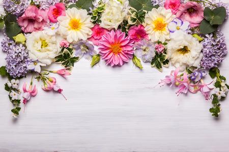 Photo pour Festive flower composition on the white wooden background. Overhead view - image libre de droit