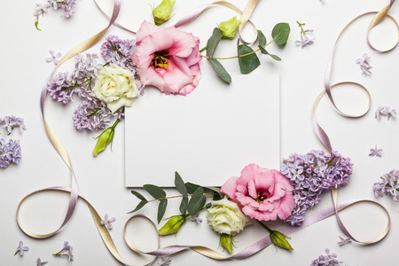 Photo pour Festive invitation card with beautiful floral border on the white textured background - image libre de droit