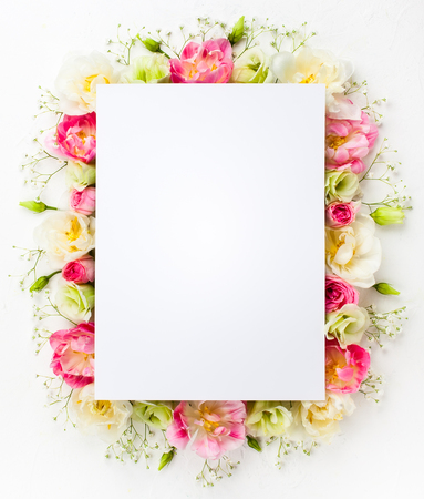 Foto de Festive flower concept : beautiful floral border on the white  background with copy space.  Flat lay. - Imagen libre de derechos