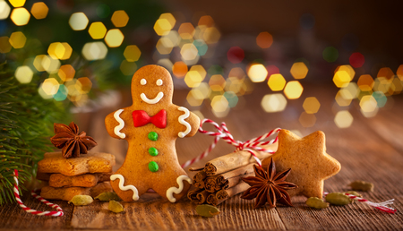 Photo for Christmas homemade gingerbread cookies and spices on the wooden background - Royalty Free Image