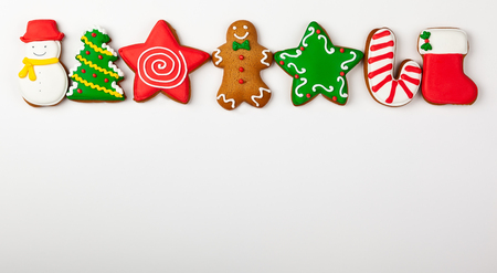Foto de Set of Christmas gingerbread on white background. Top view. Christmas concept with copy space. - Imagen libre de derechos