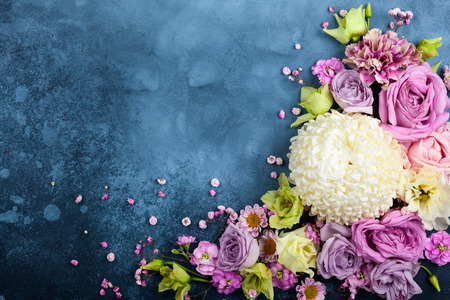 Photo for Beautiful  flowers on vintage blue background. Festive floral concept with clean space for text. Top view. - Royalty Free Image