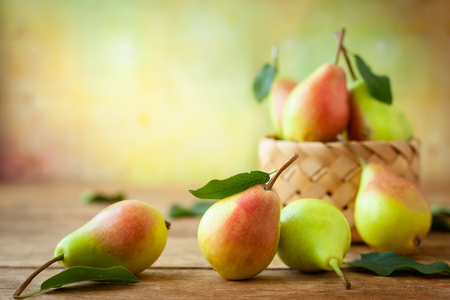 Foto für Fresh ripe pears in basket on the wooden table. Organic fruits, concept of healthy eating with copy space. - Lizenzfreies Bild