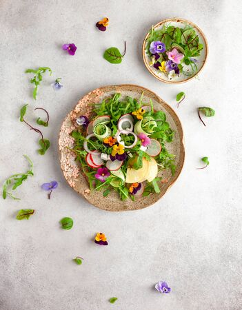 Photo for Delicious summer salad with edible flowers, vegetables, fruit, microgreens and cheese. Clean and healthy eating concept. Top view. - Royalty Free Image