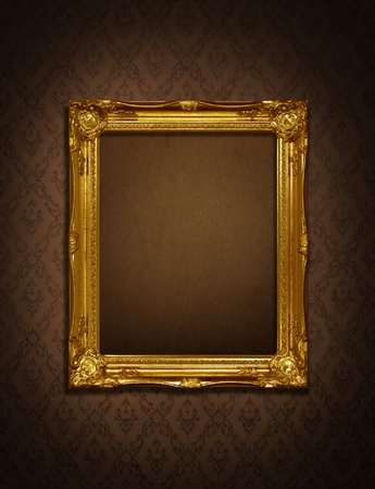Gold frame stuck on the wall wallpaper thai the dark.