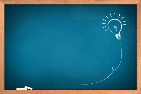 Foto de Drawing of a bulb idea on blue board  - Imagen libre de derechos