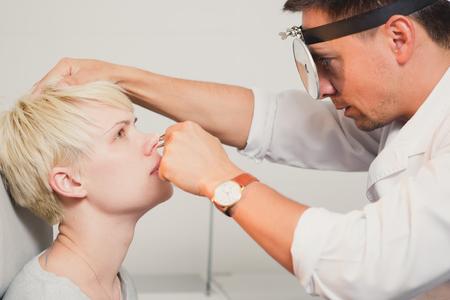 Foto für Doctor ENT checking ear with otoscope to woman patient at hospital - Lizenzfreies Bild